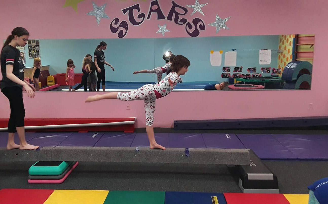 gymnast doing a backward scale